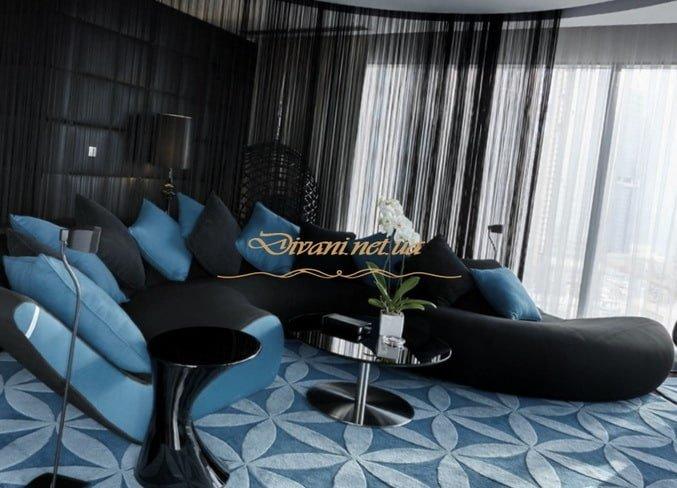 большой синий радийсный диван для гостиной