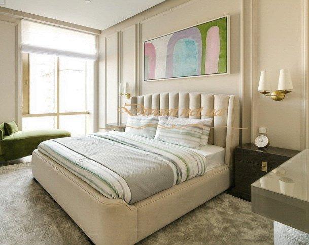 белая авторская кровать с мягким изголовьем